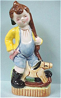 Boy With Toy Rifle And Rocking Horse