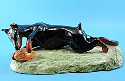 Ceramic Doberman Playing With a Football (Image1)