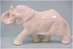 Click here to enlarge image and see more about item a01986: 1940s White Pottery Elephant Planter