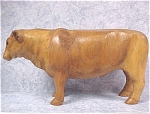 Click here to enlarge image and see more about item a04316: Carved Wood Steer