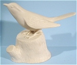 Bisque Porcelain Bird on Stump