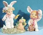 Click here to enlarge image and see more about item a04829: Resin Children in Bunny Suits
