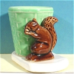 Click here to enlarge image and see more about item a04858: Morton Pottery Squirrel with Basket Planter