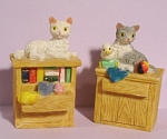 Click here to enlarge image and see more about item a05134: Resin Cats on Tables