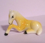 Click here to enlarge image and see more about item a05317: Miniature Bone China Palomino Lying Foal