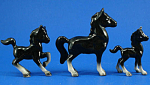 Click here to enlarge image and see more about item a05927: Early 1950s Lefton Miniature Black Horse Trio