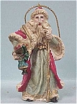 Click here to enlarge image and see more about item b00735: Handsome Resin Santa Ornament
