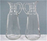 Click here to enlarge image and see more about item g00408: Anchor Hocking Cruet or Syrup Pair