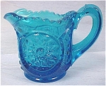 Click here to enlarge image and see more about item g00595: Light Blue Glass Miniature Cream Pitcher