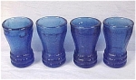 Click here to enlarge image and see more about item g00609: Four Miniature Blue Glass Child's Toy Tumblers