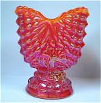 Click here to enlarge image and see more about item g00720: Argonaut Shell Orange Carnival Glass Toothpick