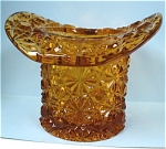 Click here to enlarge image and see more about item g00723: Amber Daisy Button Glass Top Hat Dish