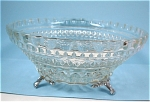 Click here to enlarge image and see more about item g00727: Small Clear Glass Dish With Metal Feet
