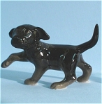 Click here to enlarge image and see more about item h01705: Hagen-Renaker Miniature Black Lab Puppy