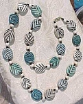 Click here to enlarge image and see more about item j00011: Pottery Bead Necklace