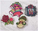 Click here to enlarge image and see more about item j00280: Three Christmas Pins & a Rose Pin