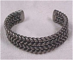 Click here to enlarge image and see more about item j00300: Twisted Wire Bangle