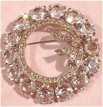 Click here to enlarge image and see more about item j00429: Coro Clear Rhinestone Wreath Pin