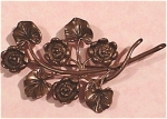 Click here to enlarge image and see more about item j00432: Tarnished Sterling Flower Pin
