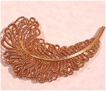 Click here to enlarge image and see more about item j00434: Feather Shaped Pin