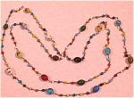 Click here to enlarge image and see more about item j00447: Old Glass Bead Necklace