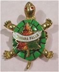 Click here to enlarge image and see more about item j00622: Niagara Falls Souvenir Turtle Pin