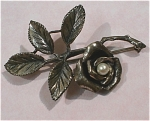 Click here to enlarge image and see more about item j00657: Unmarked Silvertone Rose with Faux Pearl Center