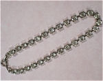 Click here to enlarge image and see more about item j00781: Rhinestone Tennis Bracelet