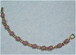 Click here to enlarge image and see more about item j00828: Unmarked Goldtone Bracelet with Purple Cabechons