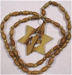 Click here to enlarge image and see more about item j00833: Wood Star / Cross Necklace