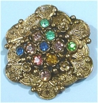 Click here to enlarge image and see more about item j00889: Little Nemo Multi Colored Rhinestone Pin