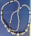 Click here to enlarge image and see more about item j01041: New 38'' Plastic Bead Necklace