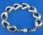Click here to enlarge image and see more about item j01160: Vintage Mexican Sterling Heart Bracelet