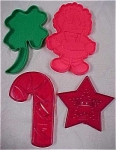 Click here to enlarge image and see more about item k00059: Four Assorted Plastic Cookie Cutters