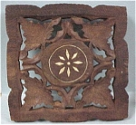 Click here to enlarge image and see more about item k00115: Carved Wood Trivet