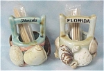 Click here to enlarge image and see more about item k00168: Florida Shell Decorated Toothpick Holder Pair