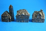 Three Miniature Metal Houses