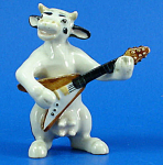 Click here to enlarge image and see more about item n01542: K6765 Cow with Guitar