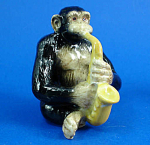Click here to enlarge image and see more about item n01602: K6721 Chimp with Sax