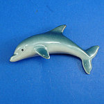 Click here to enlarge image and see more about item n02312: K268 Porcelain Dolphin Magnet
