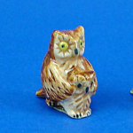 Click here to enlarge image and see more about item n02369: K999 Tiny Owl with Baby