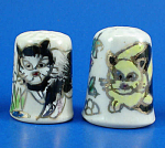 Click here to enlarge image and see more about item n02747: Hand Painted Porcelain Thimble Pair - Cats