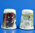 Click here to enlarge image and see more about item n02749: Hand Painted Porcelain Thimble Pair - Elephants
