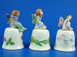 Click here to enlarge image and see more about item n02828: Hand Painted Ceramic Thimble - Fairy Trio