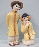 Click here to enlarge image and see more about item p00108: CAS Oriental Man & Woman