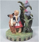 Click here to enlarge image and see more about item p00186: Austrian Handmade Pottery Girl With Deer