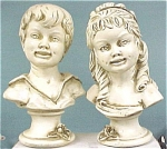 Click here to enlarge image and see more about item p00226: 1962 Universal Statuary Boy and Girl Bust