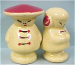 Click here to enlarge image and see more about item p00227: 1940s Pottery Oriental Boy and Girl S/P Shakers