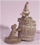 Click here to enlarge image and see more about item p00305: Miniature Metal Clown in Barrel with Dog
