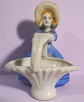 Click here to enlarge image and see more about item p00389: Lady With Basket Toothpick Holder